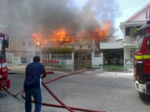 Firefighters try to contain the blaze.