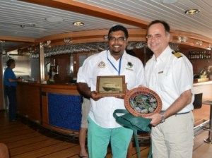 Minister Ali and CaptainKruess display tokens they received from each other.
