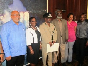 Mr. Brumell (third from right) flanked by his wife, daughter, President Ramotar and Dr. Roger Luncheon. [iNews' photo]