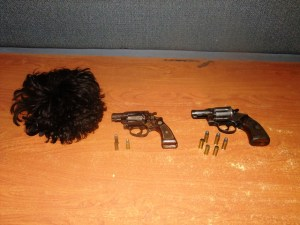 The arms and ammunition recovered by the police from the scene at South Road, Georgetown. Included is a female wig that was found on one of the men.