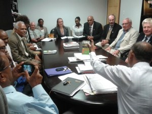 Minister Ramsammy in discussion with Canadian High Commissioner to Guyana and Canadian farmers'.