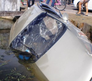 The taxi ended up in a canal as a result of the accident.