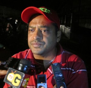 Paul Krishna speaks to the media at the scene of the fire. [iNews' Photo]