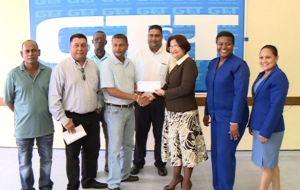 Representatives of GT&T hands over the cheque to GCB representative.