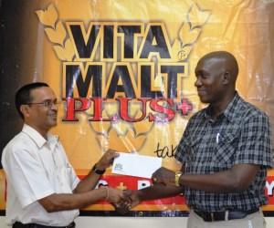 Shiv Nandalall collects Sponsorship cheque from Vita Malt's Clayton Mc Kenzie.