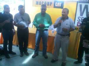 Left to right: Macorp's Product Support Manager Guillermo Escarraga, Caterpillar Representative Jose Westin, Minister of Natural Resources and the Environment Robert Persaud and Macorp's CEO, Jorge Medina at the opening of Macorp's Port Kaituma branch.
