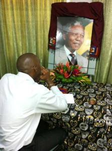 APNU's Christopher Jones signs the book of condolence