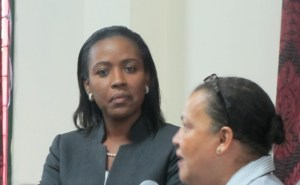 UG's Susy Lewis explains her comment on the policy to Consultant Valarie Grant. [iNews' Photo]