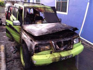 The badly damaged Suzuki Sidekick.
