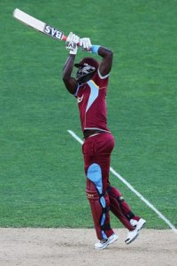 Darren Sammy in full flow as he hits straight over the top.
