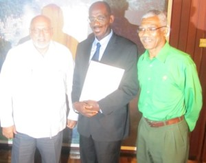 President Ramotar, Winston Moore and Opposition Leader, David Granger shortly after the swearing in ceremony. [iNews' Photo]