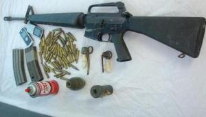The firearm, ammunition and grenades, which were recovered by the police.
