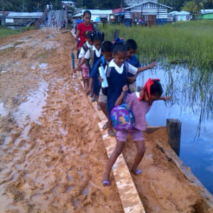 The current state of the road which students have to traverse on a daily basis.