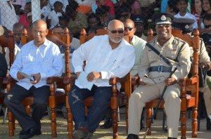 President Donald Ramotar (center) flanked by Police Commissioner, Leroy Brumell (right) and Home Affairs Minister, Clement Rohee at the farewell parade.