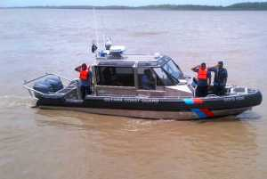 One of the Metal Shark Boats in the Demerara River as its crew salutes President Donald Ramotar and the High Command of the GDF. [iNews' Photo]