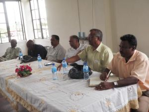 Minister Ramsammy, along with other officials at the meeting in Essequibo.