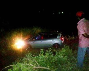 The dead man in his vehicle on the Strasphey Railway Embankment. [iNews Citizen Reporter's Photo]