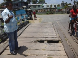 Regional Chairman Clemet Corlettee inspects the bridge of contention and immediately ordered that works be carried out on same. [iNews' Photo]