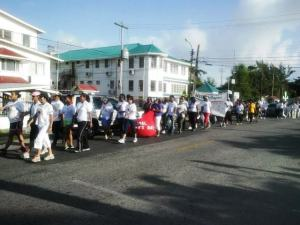 The silent walk through the streets of Georgetown in observance of International Women's Day. [iNews' Photo]