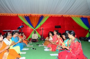 A women's group taking part in the chowtal samelaan at the Guyana International Conference Centre