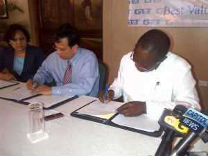 GT&T's CEO, RK Sharma and UG's VC, Dr Jacob Opadeyi sign the MoU. [iNews' Photo]