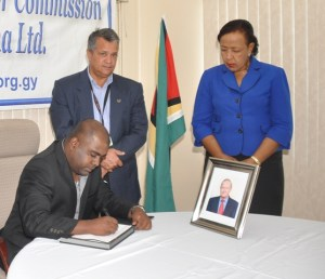 Vice-Chairman of the Private Sector Commission, Mr. Ramesh Persaud signing the Book of Condolences