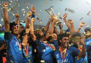 The Sri Lankan players celebrate with the World T20 trophy