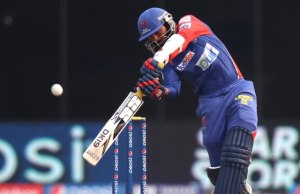 Dinesh Karthik carves the ball over the off side