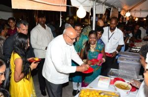 President Donald Ramotar about to sample the food on display at the launch of the event.
