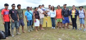 Minister Sukhai hands over assorted items to the Massakenari Village Council, Region Nine