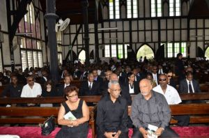 CAPTION: President Donald Ramotar, Opposition Leader David Granger and Member of Parliament Amna Ally at the funeral service of the late Bank of Guyana Governor, Lawrence Williams