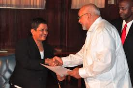Flashback: President Donald Ramotar presents credentials Ms. Dana Seetahal S.C. who was sworn in as member of the Linden Commission of Inquiry.