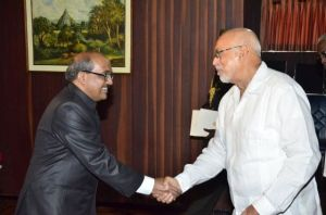 Newly accredited Indian High Commissioner Venkatachalam Mahalingam greeting President Donald Ramotar