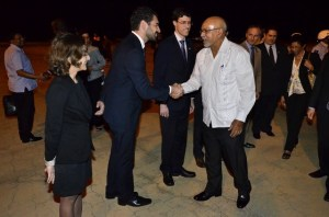President Donald Ramotar being greeted by Brazilian officials on his arrival in Brazil for the BRICS Summit.