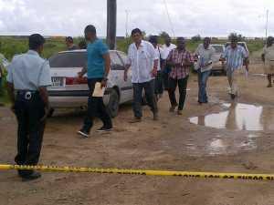 Investigators, others at the crime scene. [iNews' Photo]