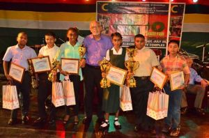 President Donald Ramotar with Region Six top National Grade Six Assessment Students who were awarded at the Berbice expo