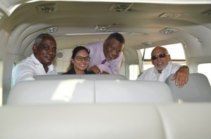 President Donald Ramotar, Prime Minister Samuel Hinds, Director, JAGS Aviation, Brionne Tiwarie and Minister of Public Works, Robeson Benn in the new Cessna Grand Caravan 208B EX. [GINA Photo]