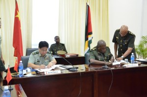 GDF Chief-of-Staff Brigadier Mark Phillips and Major General Kong Li of the People's Liberation Army, recently signed a multi - million dollar military-aid package