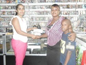 11 - year - old Garfield Dover; his mother, Maria and Co - Owner of GameXpress, Nazeema Henriques. [iNews' Photo]