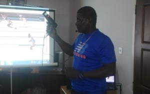 National coach and well known starter, Lyndon Wilson demonstrates the use of the Automotive Starting Gun. [iNews' Photo]