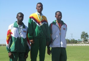 Triple Gold medalist Ornesto Thomas [center].