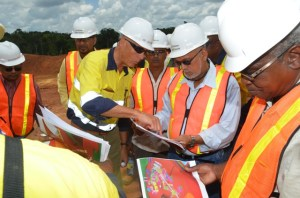 President Ramotar and Minister of Public Works, Robeson Benn being briefed on progress of works by Chief Executive Officer Scot Cladwell.  [GINA Photo]