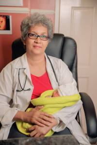 Dr Madhu Singh and Guyana's first IVF Baby.
