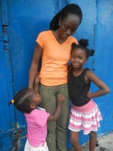 Althea Accra and two of her children. [iNews' Photo]