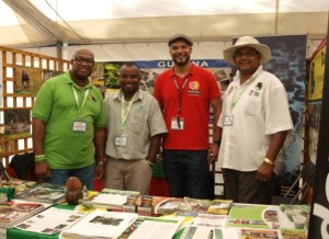 GTA Director Indranauth Haralsingh  (right) and three others in the Guyana booth at the bird fair in England. [GINA Photo]