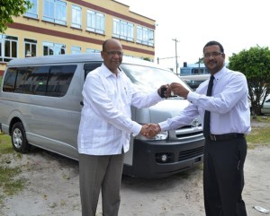Minister of Home Affairs, Clement Rohee presenting the keys to the new vehicle to Head of the Customs Anti-Narcotics Unit, James Singh. [GINA Photo]
