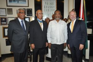 Newly appointed Honorary Consul to Sweden, Mohamed Shabbir Hussein, Former Honorary Consul to Sweden Clifford Reis, Prime Minister Samuel Hinds and Swedish Ambassador Claes Hammar. [GINA Photo]