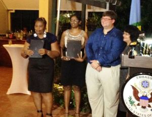 Charge d' Affaires, Bryan Hunte and the recipients of the grants.