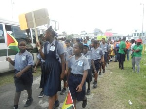 Students marching through the streets of Georgetown. [iNews' Photo]