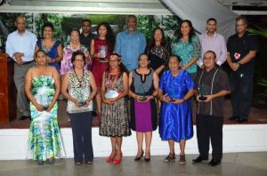 Prime Minister Samuel Hinds and other officials  with the Amerindian women honoured by the Amerindian Affairs Ministry for their outstanding contributions in various fields